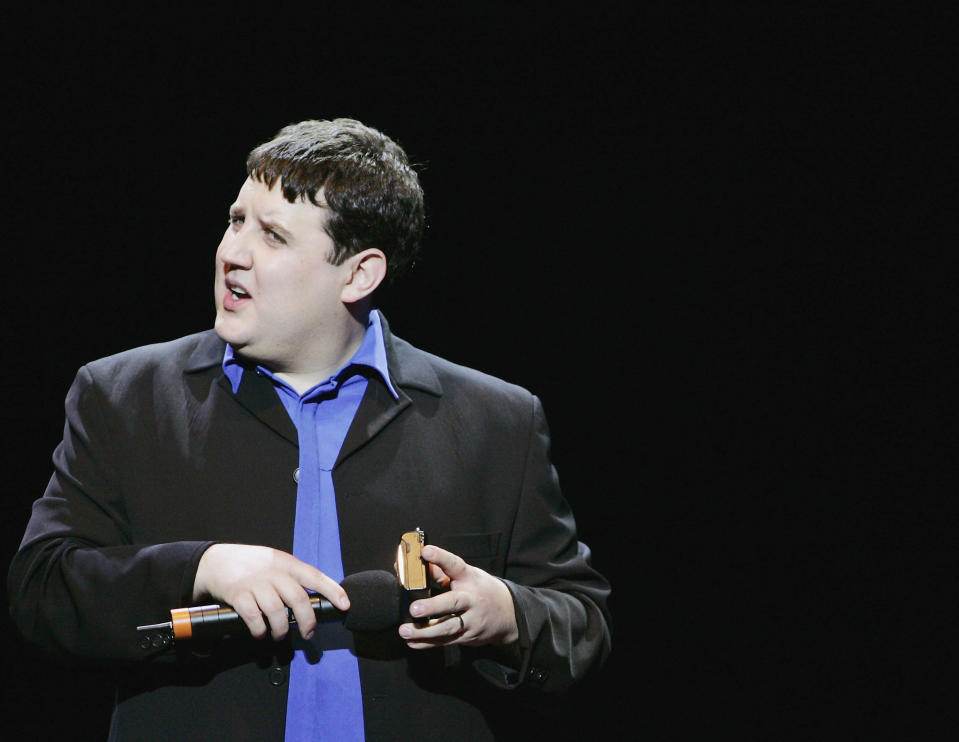 "LONDON - APRIL 6:  Comedian Peter Kay performs on stage at the ""Teenage Cancer Trust Comedy Night"", the third in a series of 5 charity shows in aid of the Teenage Cancer Trust, which run from April 4 to April 8, at the Royal Albert Hall on April 6, 2005 in London. (Photo by Jo Hale/Getty Images)"