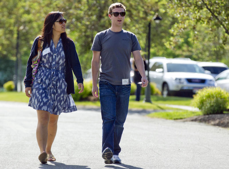 <p> FILE- In this July 9, 2011 file photo, Mark Zuckerberg, president and CEO of Facebook, walks with Priscilla Chan during the 2011 Allen and Co. Sun Valley Conference, in Sun Valley, Idaho. Zuckerberg and his wife Chan were the most generous American philanthropists in 2013, with a donation of 18 million Facebook shares, valued at more than $970 million, given to a Silicon Valley nonprofit in December. (AP Photo/Julie Jacobson, File) </p>