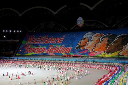 FILE PHOTO: Participants form a message during Mass Games in May Day stadium marking the 70th anniversary of North Korea's foundation in Pyongyang