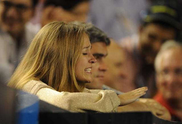 Kim Sears, girlfriend of Andy Murray of Britain gestures during his semi-final men's singles match against Novak Djokovic of Serbia on the twelfth day of the Australian Open tennis tournament in Melbourne early January 28, 2012. Djokovic won 6-3. 3-6. 6-7. 6-1. 7-5. . IMAGE STRICTLY RESTRICTED TO EDITORIAL USE STRICTLY NO COMMERCIAL USE (Photo by Greg Wood/AFP/Getty Images)