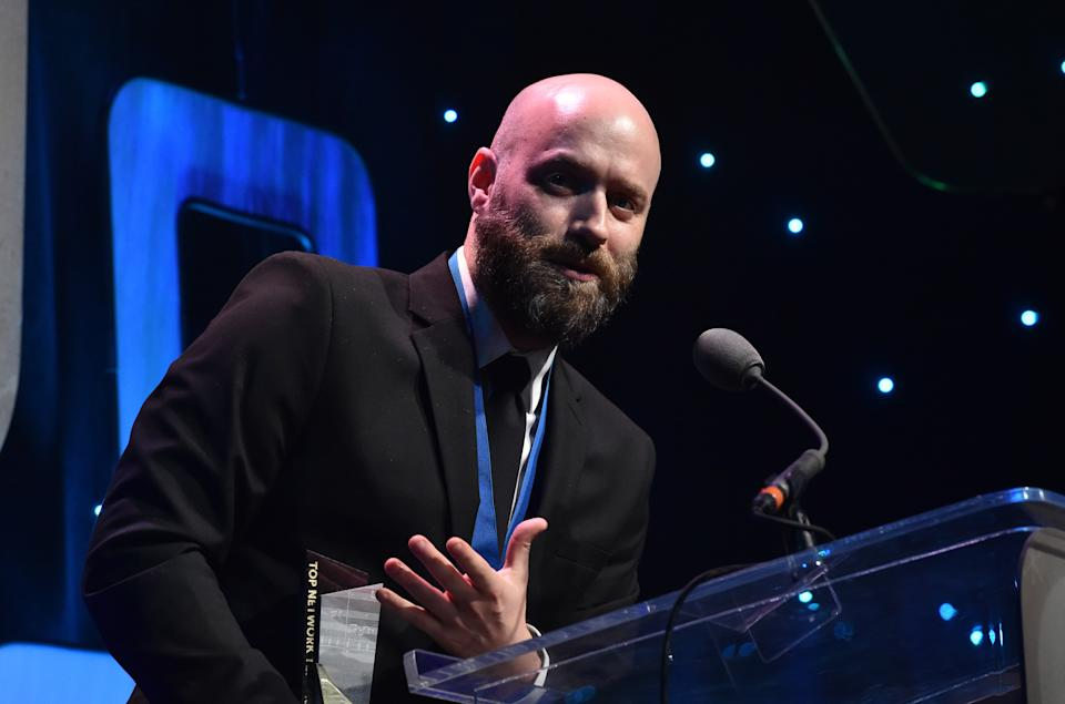 """BEVERLY HILLS, CA - MAY 23:  Composer Dan Romer accepts the award for Top Network Television Series for """"The Good Doctor' onstage at the 33rd Annual ASCAP Screen Music Awards at The Beverly Hilton Hotel on May 23, 2018 in Beverly Hills, California.  (Photo by Lester Cohen/Getty Images for ASCAP)"""