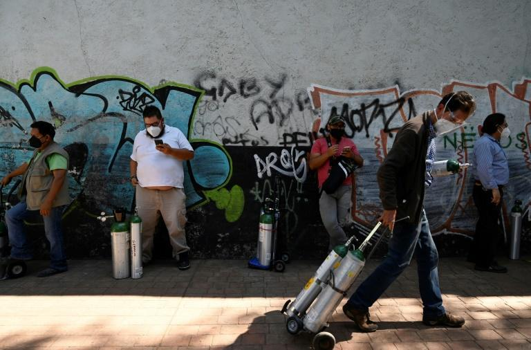 People must queue for hours to refill oxygen tanks for home coronavirus care in Mexico City