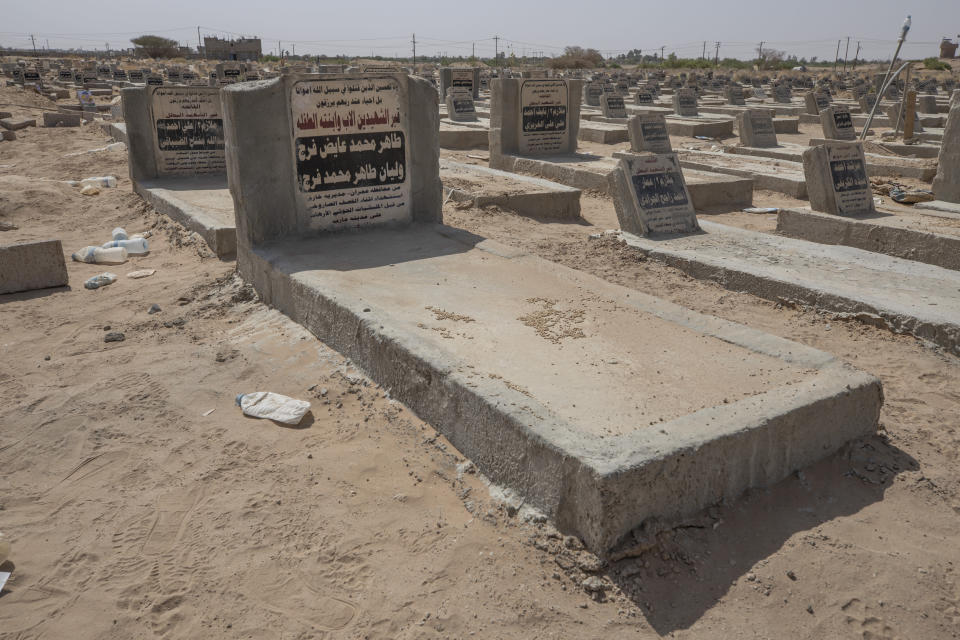 The tombstone of two-year-old Liyan Taher and her father 32-year-old Taher Farag, who were both killed on June 5, 2021, after a ballistic missile and an explosive-laden drone fired by Yemen's Houthi rebels hit a fuel station in the Rawdha neighborhood, at a mass graveyard in Marib, Yemen, Monday, June 21, 2021. (AP Photo/Nariman El-Mofty)