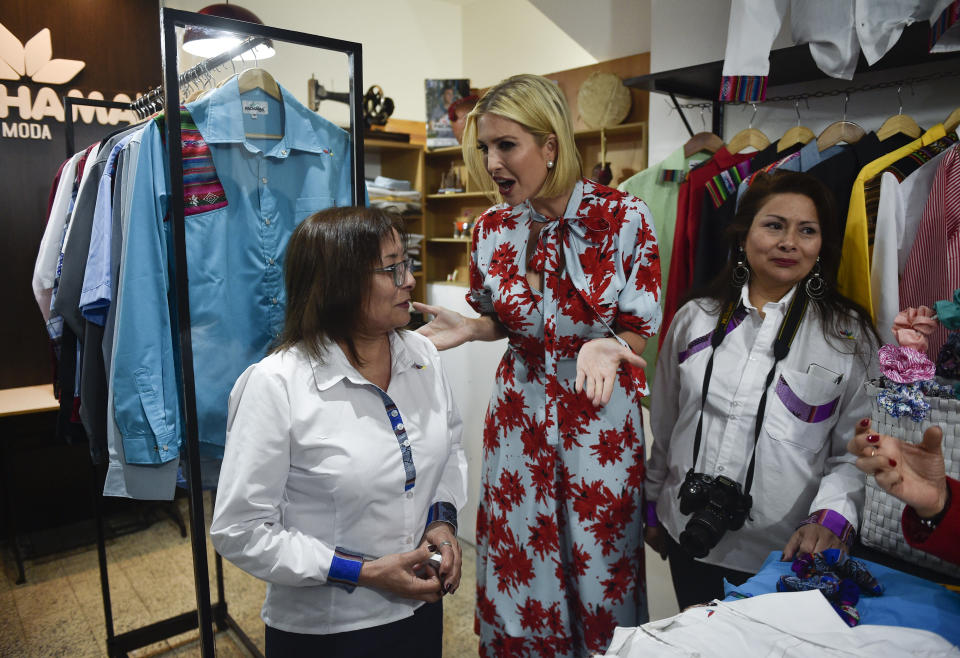 """Ivanka Trump, President Donald Trump's daughter and White House adviser, talks with Etelvina Acevedo, left, owner of the """"Today Pachama"""" clothing brand, as she visits Jujuy, Argentina, Thursday, Sept. 5, 2019. Ivanka Trump is on the second stop of her South America trip aimed at promoting women's empowerment. (AP Photo/Gustavo Garello)"""