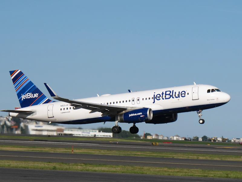 A JetBlue Airways plane about to land.