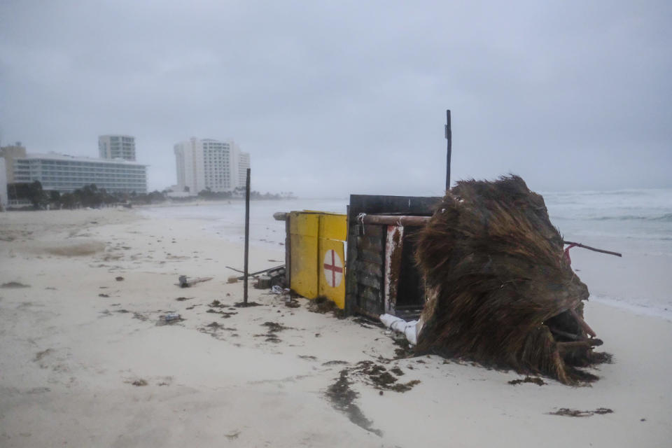 A lifeguard tower lays on its side after it was toppled over by Hurricane Delta in Cancun, Mexico, early Wednesday, Oct. 7, 2020. Hurricane Delta made landfall Wednesday just south of the Mexican resort of Cancun as a Category 2 storm, downing trees and knocking out power to some resorts along the northeastern coast of the Yucatan Peninsula. (AP Photo/Victor Ruiz Garcia)