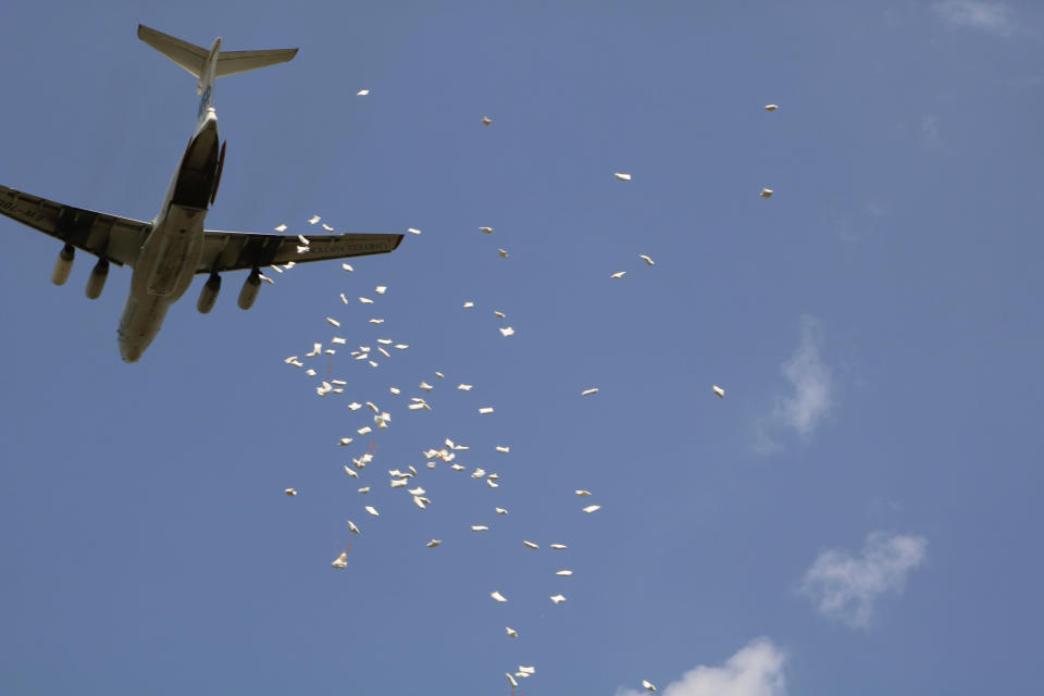 In this Friday Dec. 18 2020 photo, the World Food Program drops food aid over Pibor, South Sudan. South Sudan is one of four countries with areas that could slip into famine, the United Nations has warned, along with Yemen, Burkina Faso and northeastern Nigeria. (AP Photo/Sam Mednick)