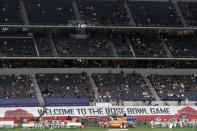 """A banner along the sideline at AT&T Stadium reads, """"Welcome To The Rose Bowl Game"""", as fans watch the teams warm up before the Rose Bowl NCAA college football game between Notre Dame and Alabama in Arlington, Texas, Friday, Jan. 1, 2021. (AP Photo/Roger Steinman)"""