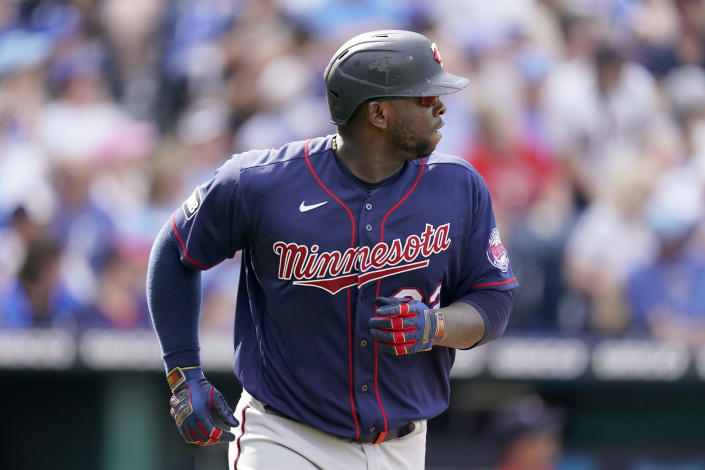 Minnesota Twins' Miguel Sano watches his two-run home run as he runs the bases during the sixth inning of a baseball game against the Kansas City Royals Saturday, June 5, 2021, in Kansas City, Mo. (AP Photo/Charlie Riedel)