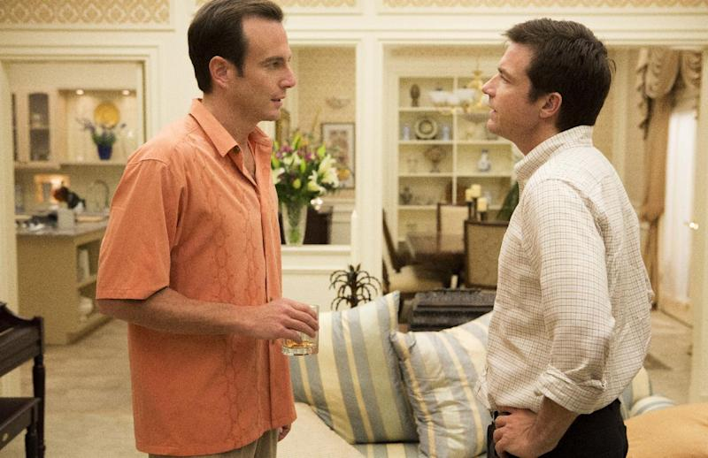 """This undated publicity photo released by Netflix shows Will Arnett, left, and Jason Bateman in a scene from """"Arrested Development."""" If Netflix's """"House of Cards"""" and """"Arrested Development"""" become the first online shows to reap Emmy nominations Thursday, July 18, it will be a watershed moment for programs that don't need television sets to make a splash. (AP Photo/Netflix, Michael Yarish)"""