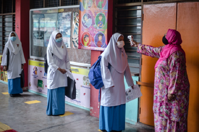 Khairy Jamaluddin said that along with Education Minister Datuk Mohd Radzi Md Jidin, he is working ensure that all staff within primary and secondary schools, including support staff, will be vaccinated. ― Picture by Firdaus Latif