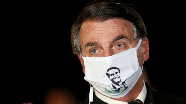 PHOTO: Brazil's President Jair Bolsonaro speaks with journalists while wearing a protective face mask as he arrives at Alvorada Palace, amid the coronavirus disease outbreak, in Brasilia, Brazil, May 22, 2020. (Adriano Machado/Reuters)