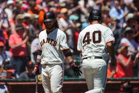 Jul 8, 2018; San Francisco, CA, USA; San Francisco Giants starting pitcher Madison Bumgarner (40) is congratulated by shortstop Brandon Crawford (35) after scoring a run during the third inning against the St. Louis Cardinals at AT&T Park. Mandatory Credit: Sergio Estrada-USA TODAY Sports