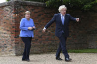Britain's Prime Minister Boris Johnson, right, welcomes German Chancellor Angela Merkel, before their bilateral meeting at Chequers, the country house of the Prime Minister, in Buckinghamshire, England, Friday July 2, 2021. Johnson is likely to push Angela Merkel to drop her efforts to impose COVID-19 restrictions on British travelers as the German chancellor makes her final visit to Britain before stepping down in the coming months. Johnson will hold talks with Merkel at his country residence on Friday. (Stefan Rousseau/Pool Photo via AP)