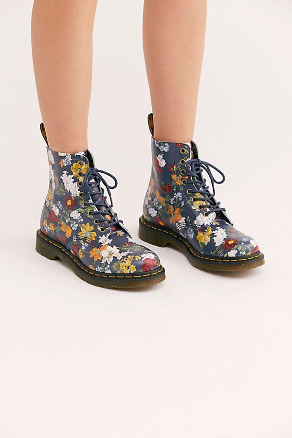 "<p>Combat boots stomped their way down the runways this season, and we are loving this fresh floral take from Dr. Martens. Bountiful blooms on a navy base bring an unexpected femininity to the punk-inspired lace-up boots, and they look great with everything from midi skirts to leggings and jeans.<br /><a rel=""nofollow"" href=""https://fave.co/2TpbOwq""><strong>Shop it:</strong> </a>$150, <a rel=""nofollow"" href=""https://fave.co/2TpbOwq"">freepeople.com</a> </p>"