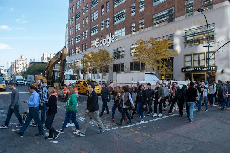 "Google announced changes to its policy on dealing with harassment after a walkout on November 1 by ""Googlers"" in offices around the world, including this group in New York (AFP Photo/Bryan R. Smith)"