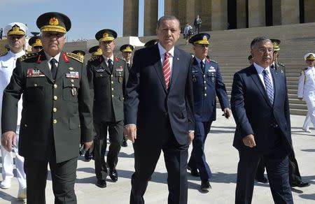 Turkey's PM Erdogan leaves after wreath-laying ceremony with members of the High Military Council at Anitkabir, mausoleum of modern Turkey's founder Mustafa Kemal Ataturk, in Ankara