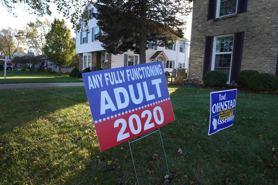 """<div class=""""inline-image__caption""""><p>Campaign signs sit in the front yard of a home on November 01, 2020 in Kenosha, Wisconsin, a state which President Donald Trump won with less than 1 percent of the vote in 2016.</p></div> <div class=""""inline-image__credit"""">Scott Olson/Getty Images</div>"""