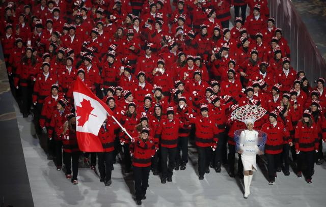 Canada's flag-bearer Hayley Wickenheiser leads her country's contingent during the opening ceremony of the 2014 Sochi Winter Olympics, February 7, 2014. REUTERS/Lucy Nicholson (RUSSIA - Tags: OLYMPICS SPORT)