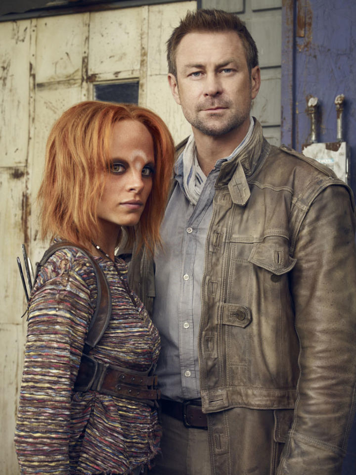 "Stephanie Leonidas as Irisa Nyira and Grant Bowler as Joshua Nolan on Syfy's ""Defiance."""