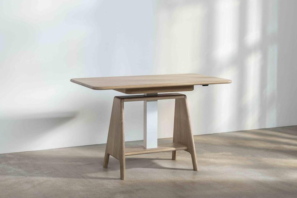 """<p>This handmade height-adjustable desk by Tom Parfitt for Benchmark proves the practical can be beautiful. It has a central sit-stand mechanism that allows you to control its height. The stand also neatly conceals unsightly cables. £1,495, <a href=""""https://benchmarkfurniture.com/product/noa-sit-stand-desk/"""" rel=""""nofollow noopener"""" target=""""_blank"""" data-ylk=""""slk:benchmarkfurniture.com"""" class=""""link rapid-noclick-resp"""">benchmarkfurniture.com</a></p>"""
