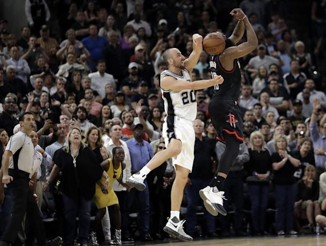 Manu Ginobili blocks James Harden on the last play of the game Tuesday night. (AP)