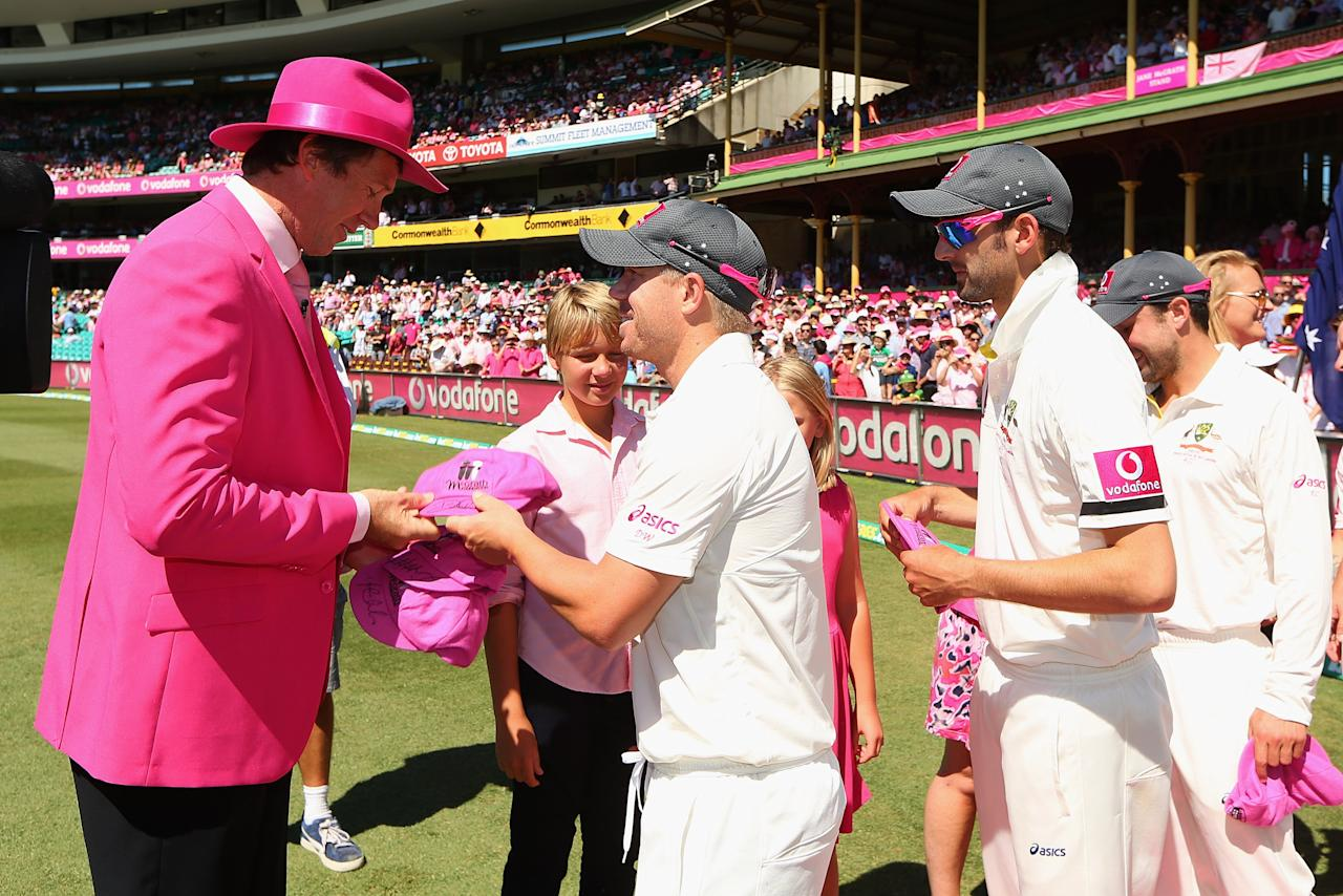SYDNEY, AUSTRALIA - JANUARY 05:  Former Australian player Glenn McGrath presents pink caps to David Warner of Australia and team mates on Jane McGrath Pink Day during day three of the Third Test match between Australia and Sri Lanka at Sydney Cricket Ground on January 5, 2013 in Sydney, Australia.  (Photo by Cameron Spencer/Getty Images)