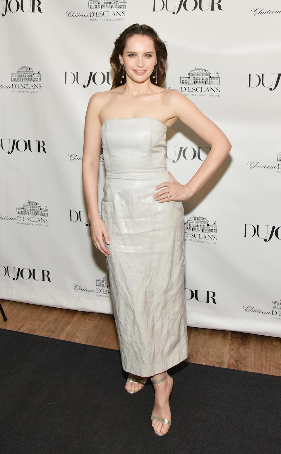 <p>Felicity kept things simple in a strapless, column dress at a party held in her honour by magazine DuJour. <em>[Photo: Getty]</em> </p>