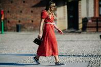 <p>Yes, those itty bitty bags that fit hardly anything in were considerd a must-have this street style season. We take our hats off to any woman who managed to survive the day with just their necessities. <em>[Photo: Katz Sinding]</em> </p>
