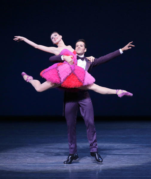 "This Thursday, Sept. 20, 2012 image released by the New York City Ballet shows Tiler Peck, left, and Robert Fairchild performing in ""Not My Girl"" at the New York City Ballet fall gala, with costumes designed by Valentino Garavani in New York. (AP Photo/New York City Ballet, Paul Kolnik)"