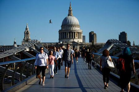 People walk across the Millennium Bridge in central London, Britain, August 3, 2018. REUTERS/Henry Nicholls