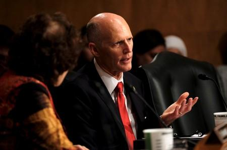 FILE PHOTO -  U.S. Senator Rick Scott (R-FL) listens as acting Homeland Security Secretary Kevin McAleenan testifies before the Senate Homeland Security and Governmental Affairs Committee in Washington