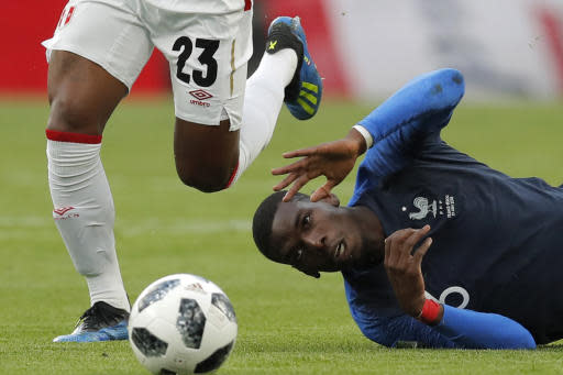 France's Paul Pogba, right lies on the pitch following a challenge by Peru's Pedro Aquino during the group C match between France and Peru at the 2018 soccer World Cup in the Yekaterinburg Arena in Yekaterinburg, Russia, Thursday, June 21, 2018. (AP Photo/Vadim Ghirda)