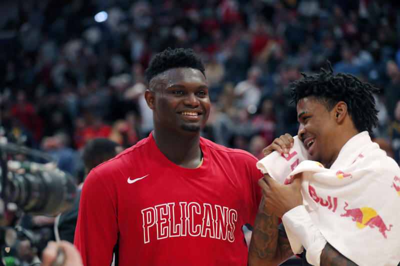NBA rookie of the year candidates, New Orleans Pelicans forward Zion Williamson, left, and Memphis Grizzlies guard Ja Morant, greet each other after an NBA basketball game in New Orleans, Friday, Jan. 31, 2020. The Pelicans won 139-111. (AP Photo/Gerald Herbert)