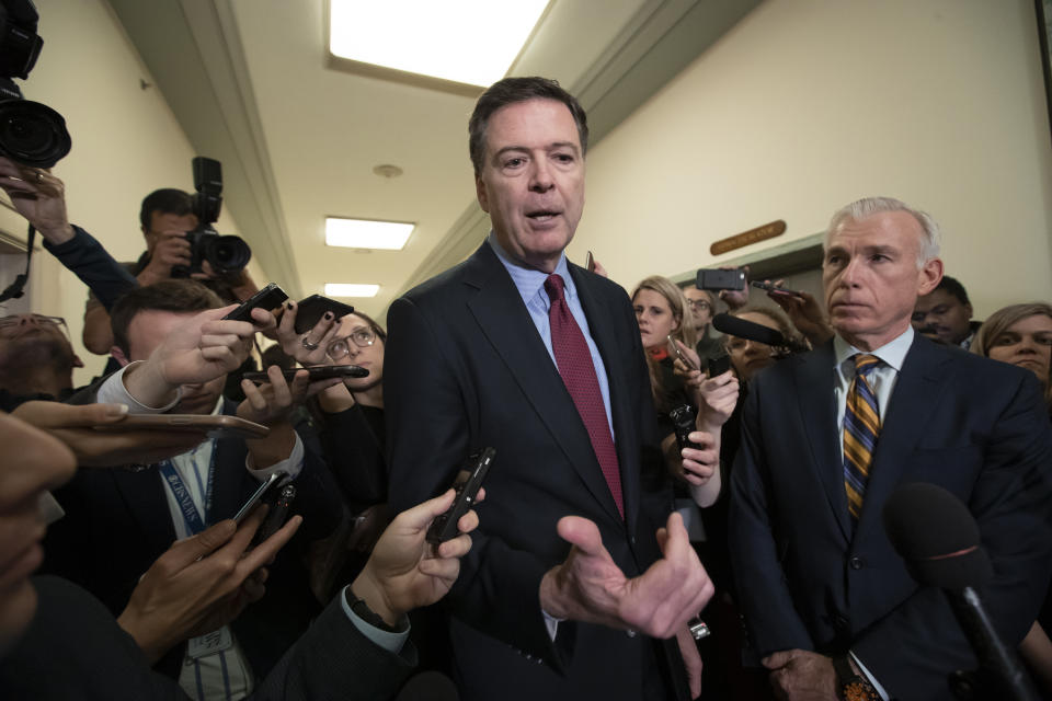 Former FBI Director James Comey, with his attorney, David Kelley, right, speaks to reporters after a day of testimony before the House Judiciary and Oversight committees, on Capitol Hill in Washington, Friday, Dec. 7, 2018. (AP Photo/J. Scott Applewhite)