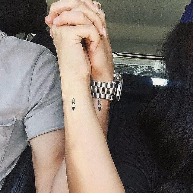 """<p>Looking for something small and subtle? You can't go wrong with this king and queen wrist tattoo for couples.</p><p><a href=""""https://www.instagram.com/p/BgyDFsfg8bQ/?utm_source=ig_embed&utm_campaign=loading"""" rel=""""nofollow noopener"""" target=""""_blank"""" data-ylk=""""slk:See the original post on Instagram"""" class=""""link rapid-noclick-resp"""">See the original post on Instagram</a></p>"""