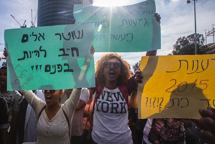 Israelis take part in a demonstration in Tel Aviv called by members of the Ethiopian community against alleged police brutality and institutionalised discrimination, on May 3, 2015 (AFP Photo/Jack Guez)