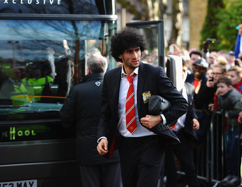 Marouane Fellaini gets off the team bus before a match against Crystal Palace.