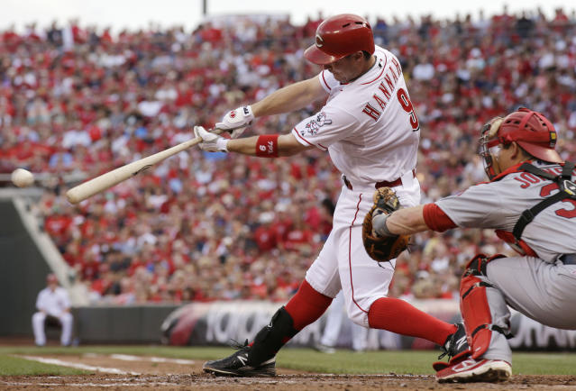 Cincinnati Reds' Jack Hannahan hits a single off St. Louis Cardinals starting pitcher Jake Westbrook to drive in two runs in the first inning of a baseball game, Saturday, Aug. 3, 2013, in Cincinnati. Rob Johnson catches at right. (AP Photo/Al Behrman)
