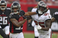 Atlanta Falcons' Avery Williams, left, stiff arms Tampa Bay Buccaneers defensive back Jamel Dean on a punt return during the second half of an NFL football game Sunday, Sept. 19, 2021, in Tampa, Fla. (AP Photo/Mark LoMoglio)