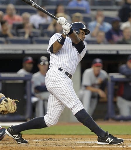 New York Yankees' Curtis Granderson watches his home run during the first inning of a baseball game against the Minnesota Twins at Yankee Stadium in New York, Monday, April 16, 2012. (AP Photo/Seth Wenig)