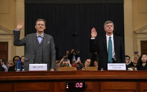 <span>US diplomats George Kent, left, and Bill Taylor being sworn in ahead of the first day of public impeachment hearings</span> <span>Credit: Chip Somodevilla/Getty Images </span>