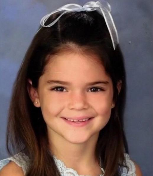 """<p>The second-youngest Jenner already knew how to charm the camera in her school photos with a white ribbon tied in her hair.<i>(Photo: <a href=""""https://instagram.com/p/vGcZgujo6C/"""">Instagram</a>)</i></p>"""