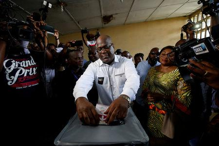 FILE PHOTO: Felix Tshisekedi, leader of the Congolese main opposition the Union for Democracy and Social Progress (UDPS) party and a presidential candidate, casts his ballot at a polling station in Kinshasa, Democratic Republic of Congo, December 30, 2018. REUTERS/Baz Ratner/File Photo
