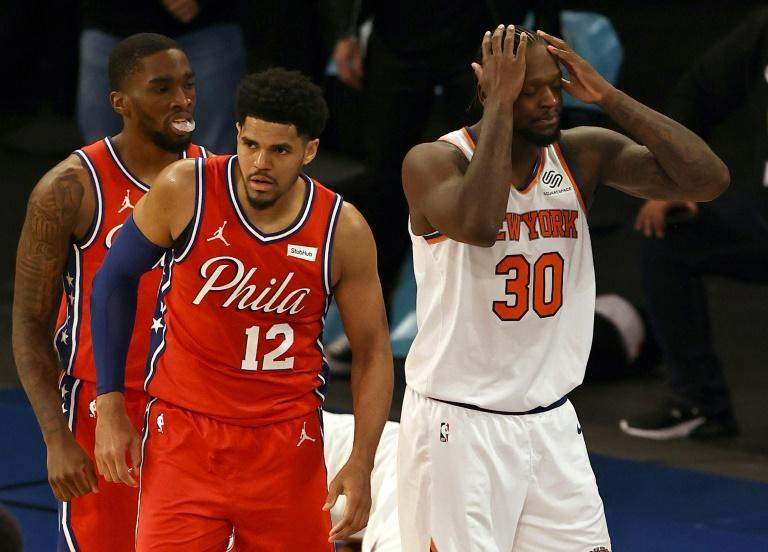 New York's Julius Randle reacts after he is called for fouling Philadelphia's Tobias Harris in the final seconds of the 76ers' 101-100 NBA overtime victory over the Knicks