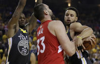 Golden State Warriors' Alfonzo McKinnie, left, and Stephen Curry defend against Toronto Raptors' Marc Gasol (33) in the first quarter of Game 4 of basketball's NBA Finals Friday, June 7, 2019, in Oakland, Calif. (AP Photo/Ben Margot)