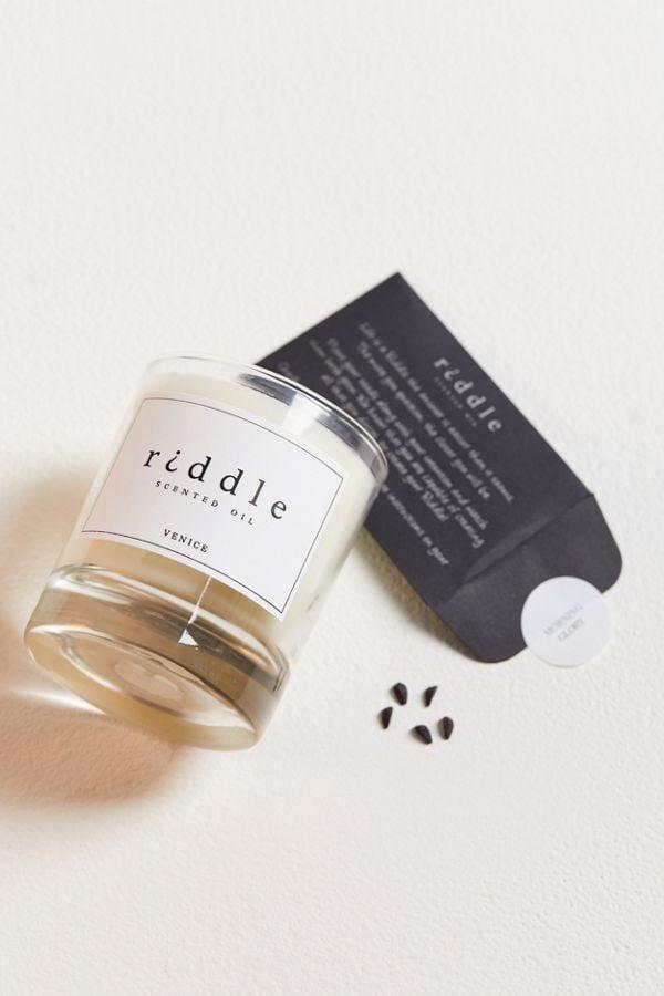 """<p>This cool <a href=""""https://www.popsugar.com/buy/Riddle-Oil-Candle-478322?p_name=Riddle%20Oil%20Candle&retailer=urbanoutfitters.com&pid=478322&price=48&evar1=fit%3Aus&evar9=46483753&list1=shopping%2Cwellness%2Cself%20care%2Chealth%20and%20wellness%2Curban%20outfiters&prop13=api&pdata=1"""" rel=""""nofollow"""" data-shoppable-link=""""1"""" target=""""_blank"""" class=""""ga-track"""" data-ga-category=""""Related"""" data-ga-label=""""https://www.urbanoutfitters.com/shop/riddle-oil-candle?category=SEARCHRESULTS&amp;color=002&amp;quantity=1&amp;size=ONE%20SIZE&amp;type=REGULAR"""" data-ga-action=""""In-Line Links"""">Riddle Oil Candle</a> ($48) comes with flower seeds, so you can reuse your candle once you've burned it down and turn it into a flower pot.</p>"""