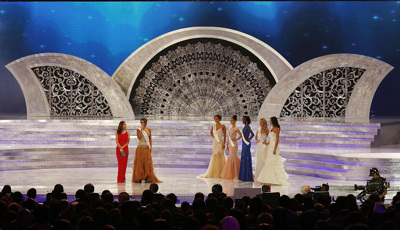 NUSA DUA, INDONESIA - SEPTEMBER 28: The six finalists of the Miss World Competition from left Miss France, Miss Philippines, Miss Ghana, Miss Brazil, Miss Spain, and Miss Gibraltar wait to hear who the second runner-up will be during the Miss World 2013 final on September 28, 2013 in Nusa Dua, Indonesia. (Photo by Ed Wray/Getty Images)