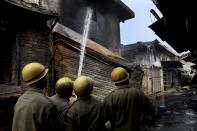 Fire fighters douse a fire at Gokul Puri tyre market which was burnt Tuesday in New Delhi, India, Wednesday, Feb. 26, 2020. At least 20 people were killed in three days of clashes in New Delhi, with the death toll expected to rise as hospitals were overflowed with dozens of injured people, authorities said Wednesday. The clashes between Hindu mobs and Muslims protesting a contentious new citizenship law that fast-tracks naturalization for foreign-born religious minorities of all major faiths in South Asia except Islam escalated Tuesday. (AP Photo/Manish Swarup)
