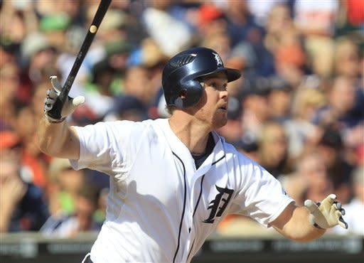 Detroit Tigers' Brennan Boesch watches his three-run home run to right field during the sixth inning of a baseball game against the Chicago White Sox in Detroit, Saturday, July 21, 2012. (AP Photo/Carlos Osorio)